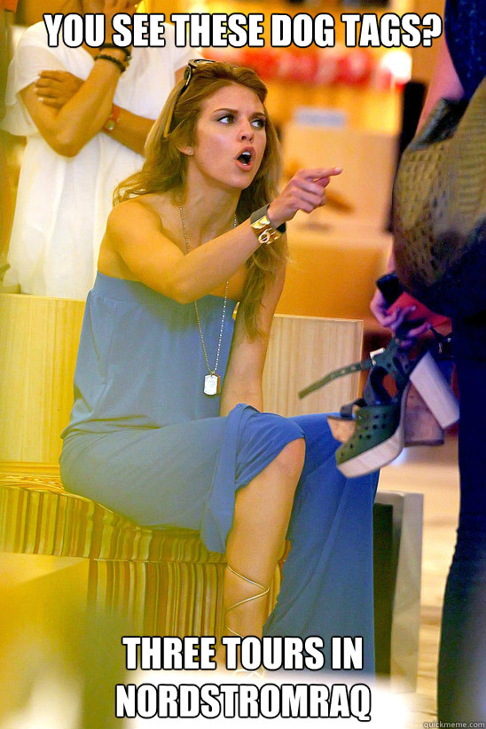 young female shopper appears to be angry while trying on shoes.