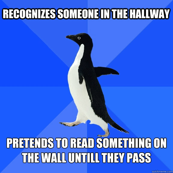 recognizes someone in the hallway pretends to read something - Socially Awkward Penguin