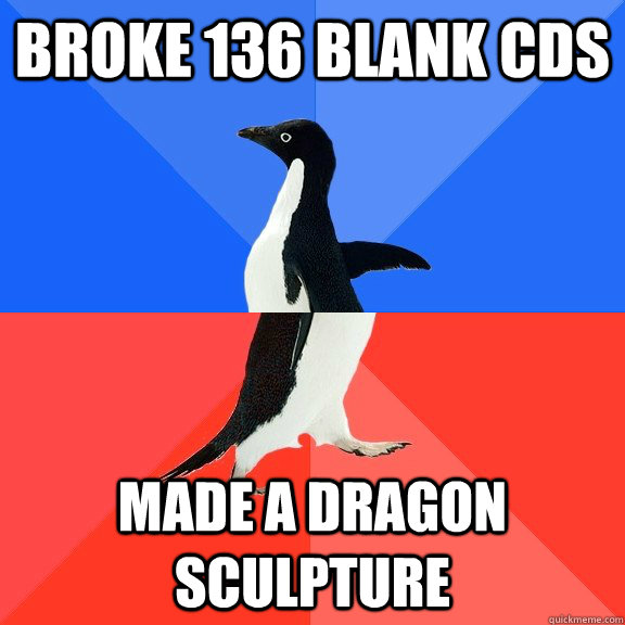 broke 136 blank cds made a dragon sculpture - Socially Awkward Awesome Penguin