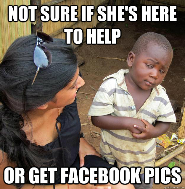 not sure if shes here to help or get facebook pics - Skeptical Third World Child