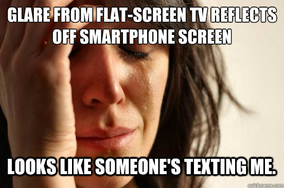 glare from flatscreen tv reflects off smartphone screen loo - First World Problems
