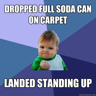 dropped full soda can on carpet landed standing up - Success Kid