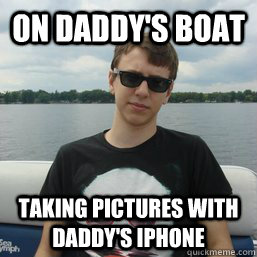 on daddys boat taking pictures with daddys iphone -