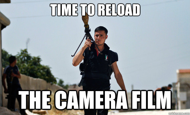 time to reload the camera film  - Ridiculously Photogenic Syrian Soldier