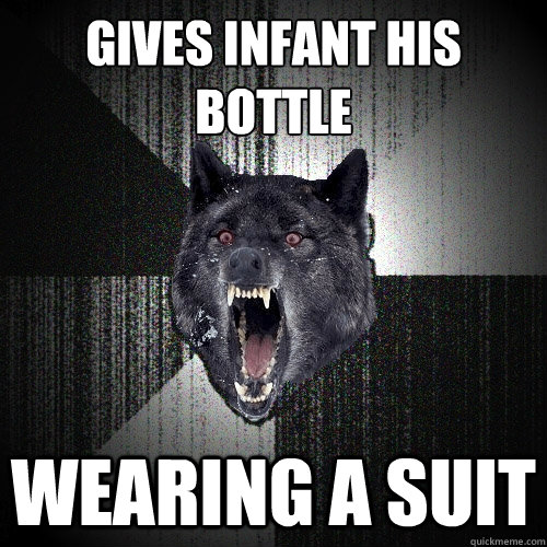 gives infant his bottle wearing a suit - Insanity Wolf