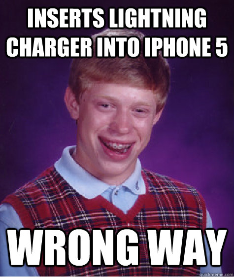 inserts lightning charger into iphone 5 wrong way - Bad Luck Brian
