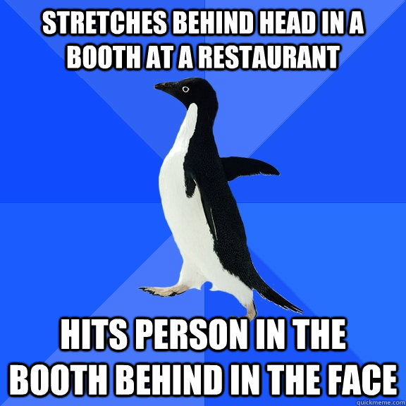 stretches behind head in a booth at a restaurant hits pers - Socially Awkward Penguin