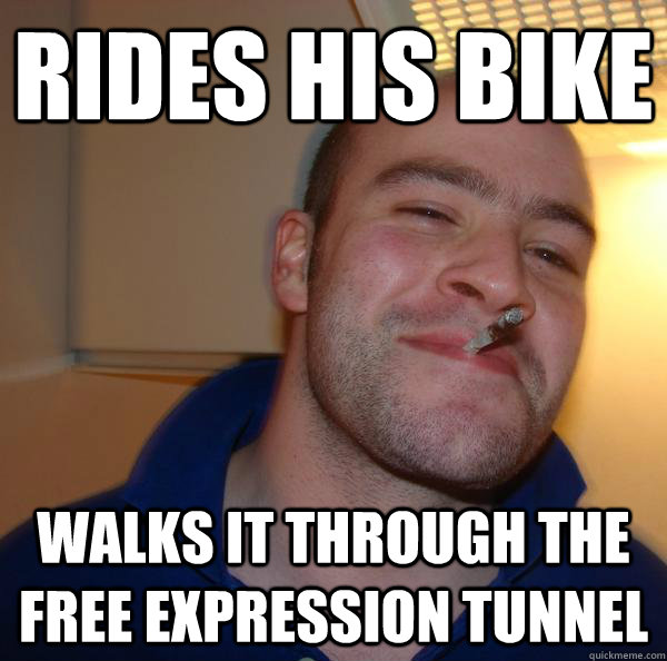 rides his bike walks it through the free expression tunnel - Good Guy Greg