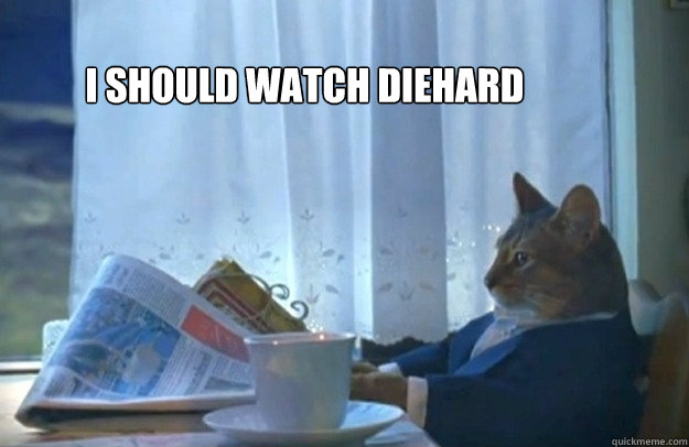 i should watch diehard  - Sophisticated Cat