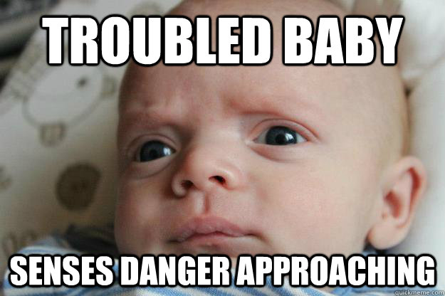 troubled baby senses danger approaching - troubled baby