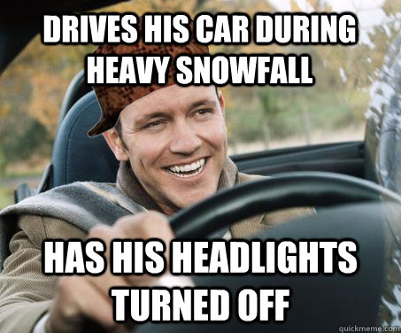 drives his car during heavy snowfall has his headlights turn - SCUMBAG DRIVER
