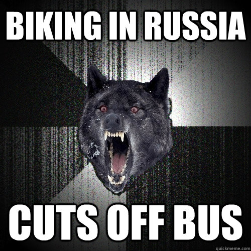 biking in russia cuts off bus - Insanity Wolf